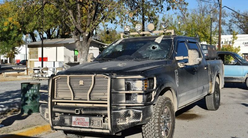 A bullet-riddled pick-up truck is pictured after clashes sparked by suspected cartel gunmen in a northern Mexican town that killed 20 people this weekend, in Villa Union, Coahuila